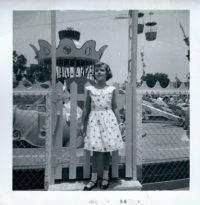 Carol Ann in front of Dumbo Ride. Disneyland July, 1956.